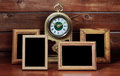 Old photo frames and antique clock on wooden table Stock Photos