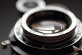 Old photographic lens close-up. Royalty Free Stock Images