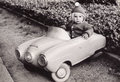 Old Photography of a little girl in a toy car Royalty Free Stock Photo