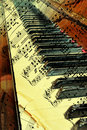 Old piano with ancient note sheets Stock Photo