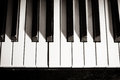 Old piano keyboard close up as a music background black and white image Stock Photos