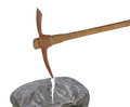 Old pick axe breaking rock isolated. Royalty Free Stock Images