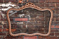 Old picture frame a a red brick wall Royalty Free Stock Photo
