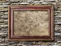 Old picture frames with cracked canvas on a brick wall Royalty Free Stock Image