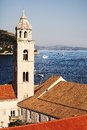 Old picturesque historic port town of dubrovnik in croatia viewed from above with a view on a church and the adriatic sea Royalty Free Stock Photos