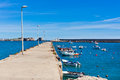 Old pier with boats at sagres portugal sunny day Stock Images