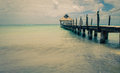 Old pier at caribbean beach Stock Photos