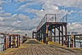 Old pier in rotterdam hdr jetty clouds bleu sky wood woden steel industrial harbor high definition range Stock Photography