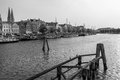 Old pier on trave in luebeck boats Stock Photo