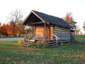 Old pioneer log cabin this is from the pre civil war era on a settlement the photo was taken at sunset in november Stock Photos