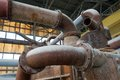 Old pipes and valves in petrochemical factory industrial plant Royalty Free Stock Photos