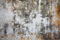 Old plastered stone surface gray and yellow Stock Photo