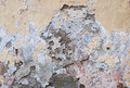 Old plastered wall abstract vintage painted background with many layers of worn paint in various colors and broken plaster texture Royalty Free Stock Image