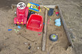 Old playground childrens sandbox with toys in autumn after rain Stock Photo