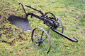 The old plow on horse draft lies on a grass Royalty Free Stock Photo