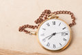 Old pocket watch background old paper Royalty Free Stock Images