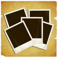 Old polariods on vintage paper Royalty Free Stock Photo