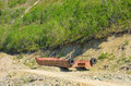 Old pontoons abandoned beside an old gold mine in northern bc equipment used for dredging as seen on a gravel pit a mined area Royalty Free Stock Photos