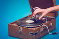 Old portable gramophone with female hand Royalty Free Stock Photo