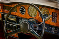 Old postcard with driver's cockpit of a vintage classic car Royalty Free Stock Photo