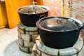 Old pots on brick ovens barely used ever Royalty Free Stock Photo