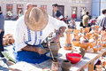 Old potter image showing an at work at the pottery market in sibiu romania Stock Photo
