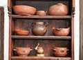 Old pottery jugs jars and apply on the shelf pots vases pestle Stock Image