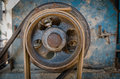 Old pulley of husk seperated machine Royalty Free Stock Photo