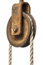 Old pulley with rope Royalty Free Stock Images