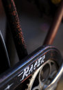 Old racer bicycle closeup of showing chain guard and rusty frame Stock Images