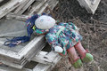 Old rag doll forgotten children toy on the ruins Stock Images