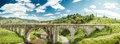Old railroad bridge on a background of blue sky Stock Photo