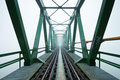 Old railroad bridge in fog Royalty Free Stock Photography