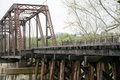 Old railroad bridge a very now closed viewed from the side showing the framework and the original wood supports Royalty Free Stock Photos