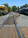 Old railroad tracks at a junction on a sunny day Stock Images