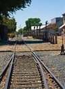 Old railroad tracks at a junction on a sunny day Royalty Free Stock Image