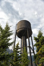 Old railroad water tower in field canada Stock Photos