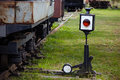 Old railway arrow with a lantern Royalty Free Stock Image
