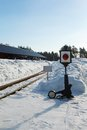 Old railway arrow with a lantern in snow Stock Photos