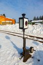 Old railway arrow with a lantern in snow Royalty Free Stock Photos