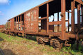 Old railway wagon on siding and waiting to cassation or repair Stock Photography