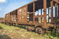 Old railway wagon on siding and waiting to cassation or repair Royalty Free Stock Photography