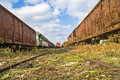 Old railway wagon on siding and waiting to cassation or repair Stock Photos
