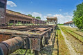 Old railway wagon on siding and waiting to cassation or repair Royalty Free Stock Photo