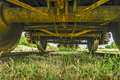 Old railway wagon on track standing the which is overgrown with grass Stock Image