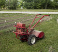 Old rear tine rototiller a ready to begin work Royalty Free Stock Images