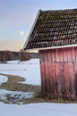 Old red barn in snowy landscape Royalty Free Stock Photo