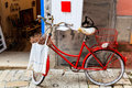 Old Red Bicycle at the Shop Door in Rovinj Royalty Free Stock Photo