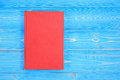 Old red book on wooden plank background. Blank empty cover for d Royalty Free Stock Photo