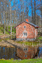 Old red brick building over pond Royalty Free Stock Photo
